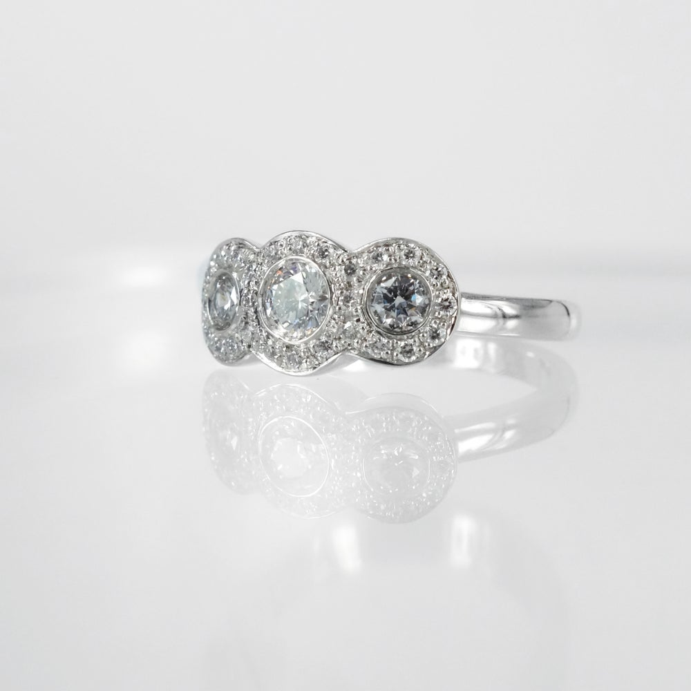 Image of Three stone diamond cluster engagement ring