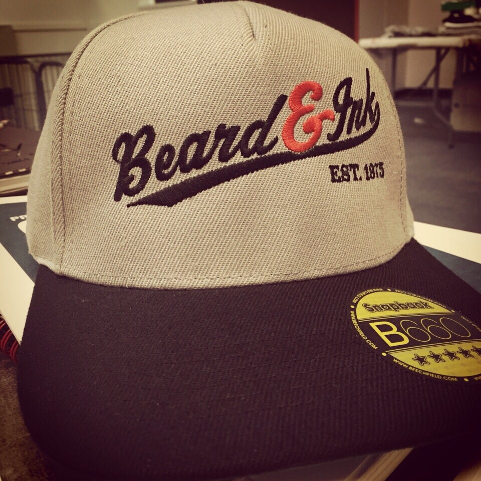 Image of Beard and Ink Script Logo Unisex Grey and Black Snapback Cap