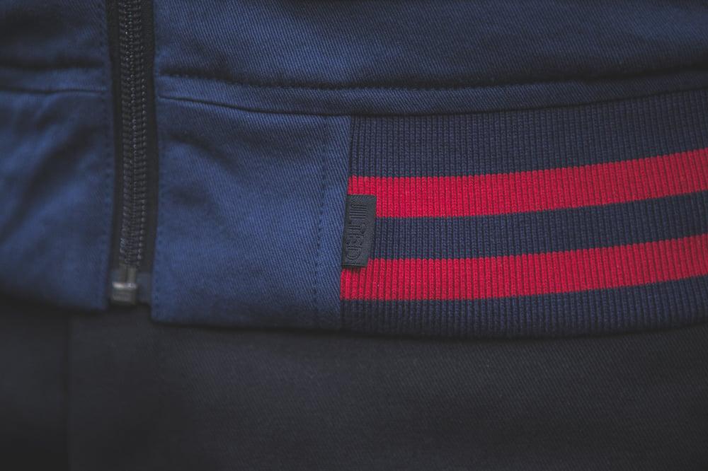 Image of PAID sleeveless varsity