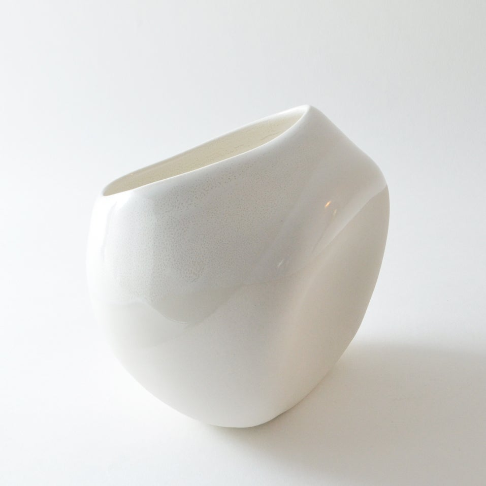 Image of white altered porcelain vessel