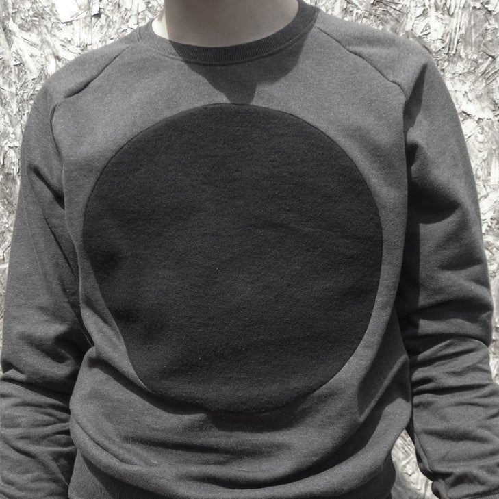 Image of GREY LABEL LUNAR RAGLAN SWEATSHIRT IN DARK SIDE HEATHER BLACK W/ BLACK CIRCLE