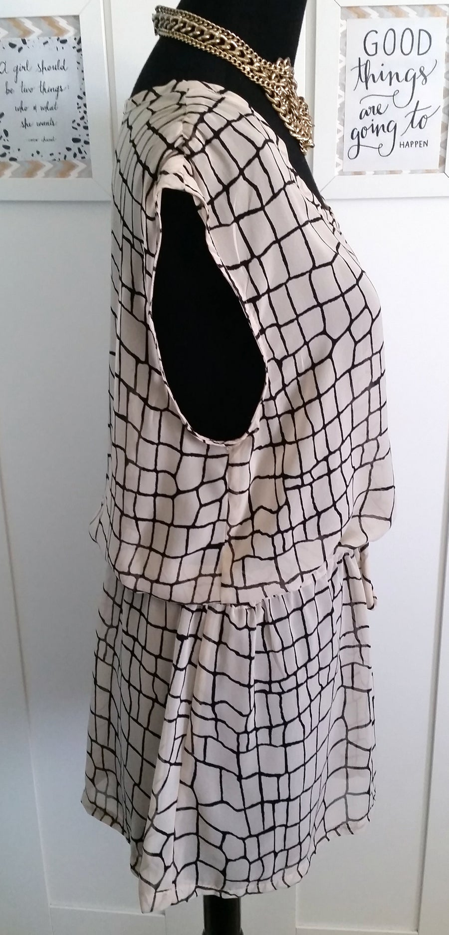 Image of Sheer Nude w/ graphic lines tunic top