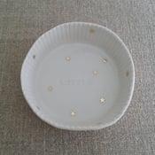 Image of Assiette moule à gâteau étoiles or