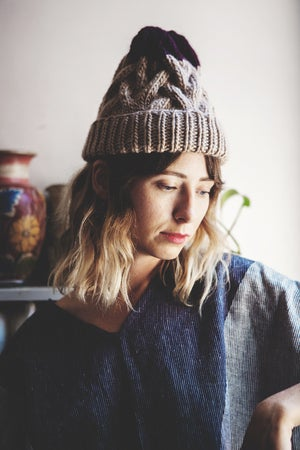 Image of Omemee cabled toque of silk+ alpaca + merino wool (shown in colourblocked fawn + plum )