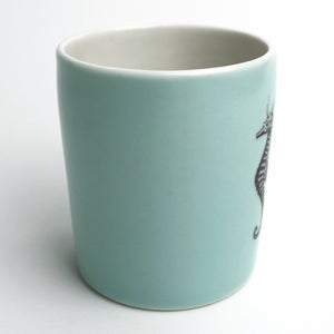 Image of 16oz tumbler in aqua with seahorse