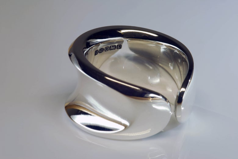 Image of 'WAISTED' ring.