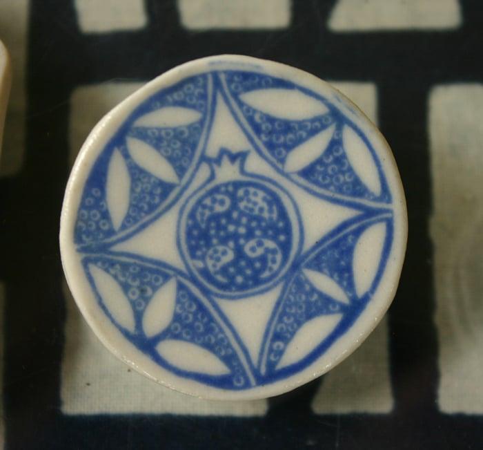 Image of pomegranate brooch porcelain