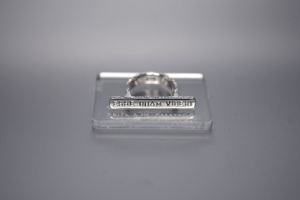 Image of silver plain ring with inscription in Latin