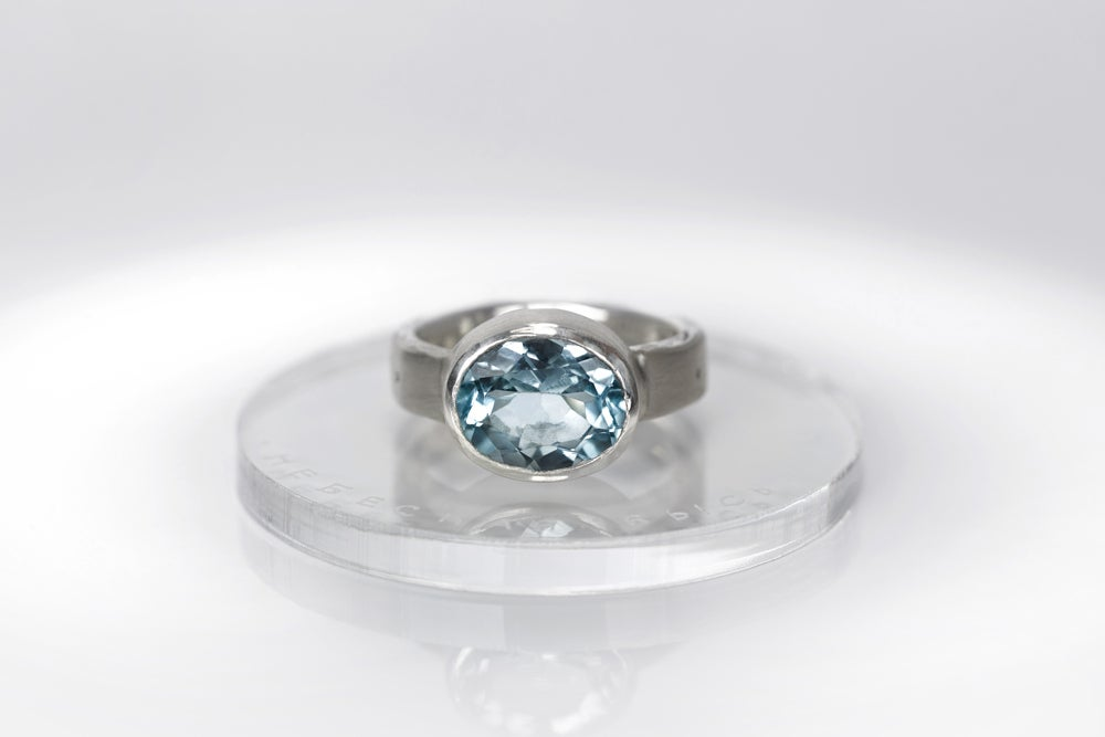 Image of sterling silver ring with blue topaz