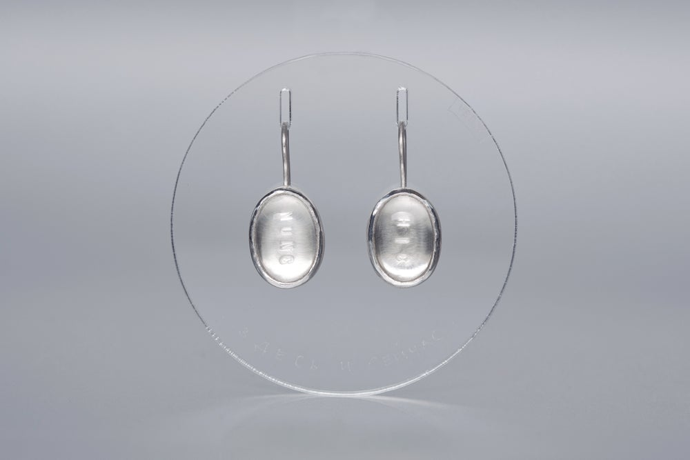 Image of silver earrings with rock crystals