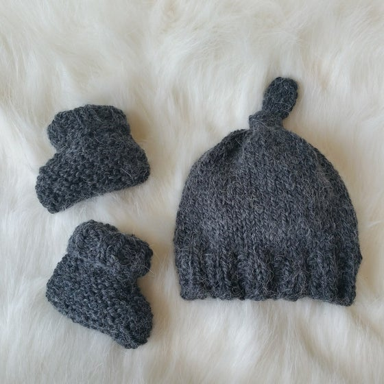 Image of Newborn Hand Knit Booties and Top Knot Hat Set