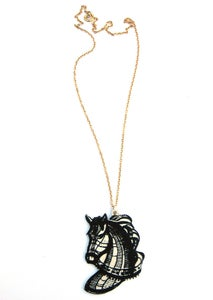 Image of black and white horse necklace
