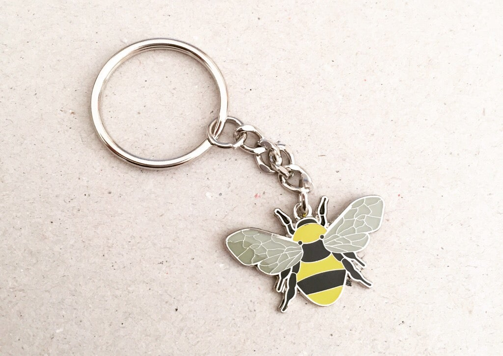 Image of Manchester Bee BeeKeeper Enamel Keyring in Yellow