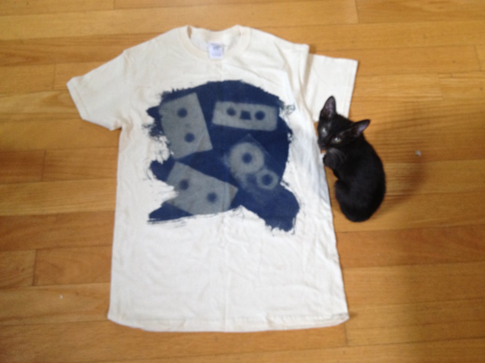Image of blue tee one