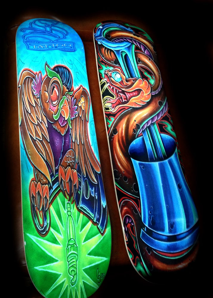 Image of skate deck  snake and piston