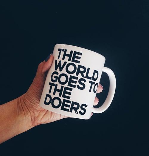 Image of The World Goes to The Doers 11 oz. Mug