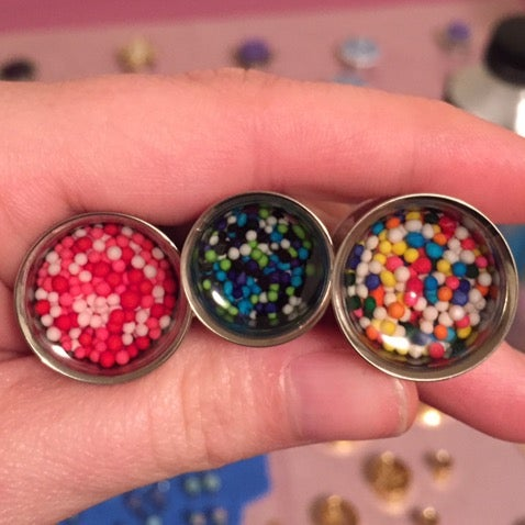 "Image of Sprinkle Plugs (sizes 2g-2"")"