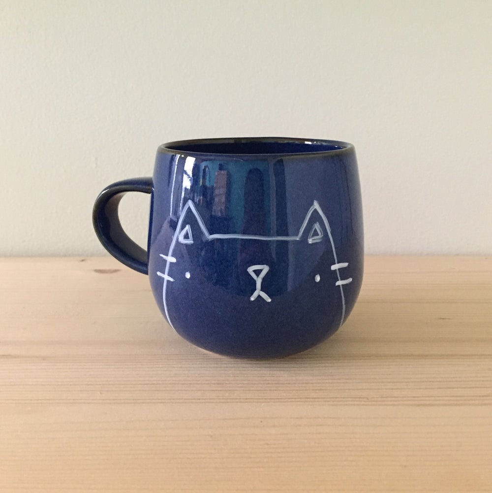 Image of blue glaze mugs -- ready to ship!