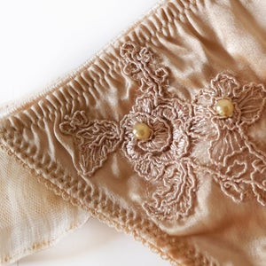 Image of INESS Nude Silk & Guipure Ruffled Thong