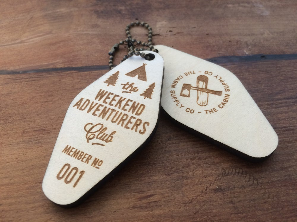 Image of birch ply wooden laser etched adventurers club key fob