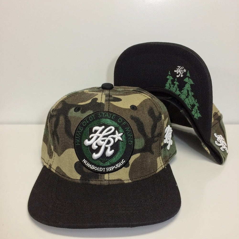 "Image of ""Referrals"" Camo Snapback - Flat or Curved Bill"