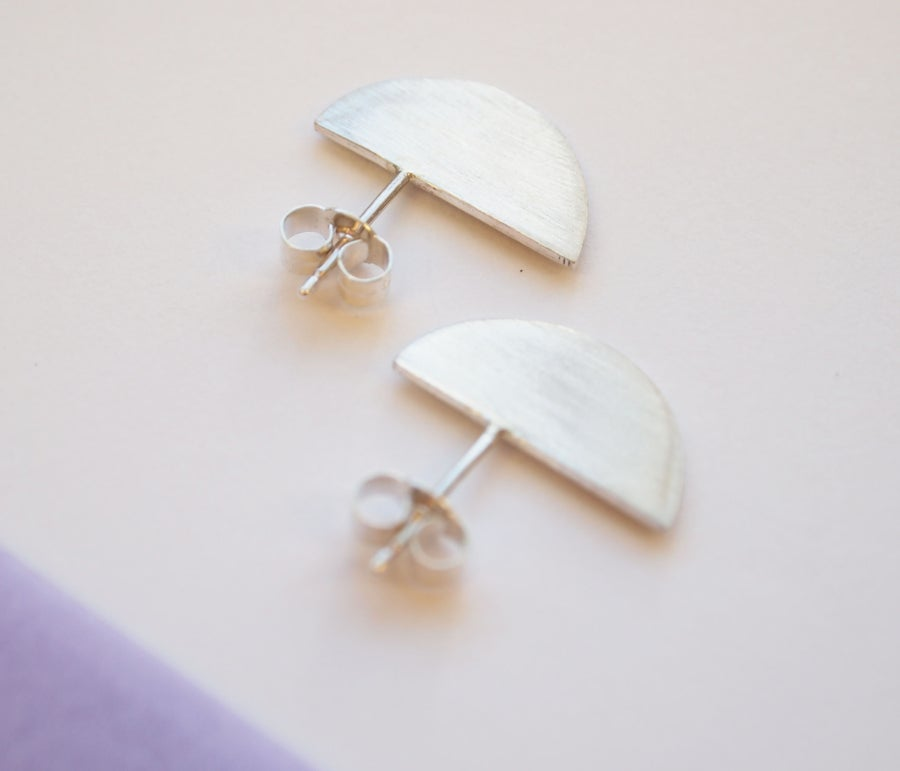 Image of half moon studs