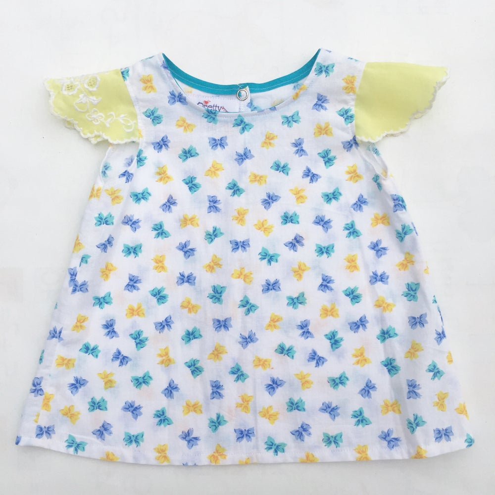Image of Baby doily sleeved dress - size 00 - blue and yellow bows