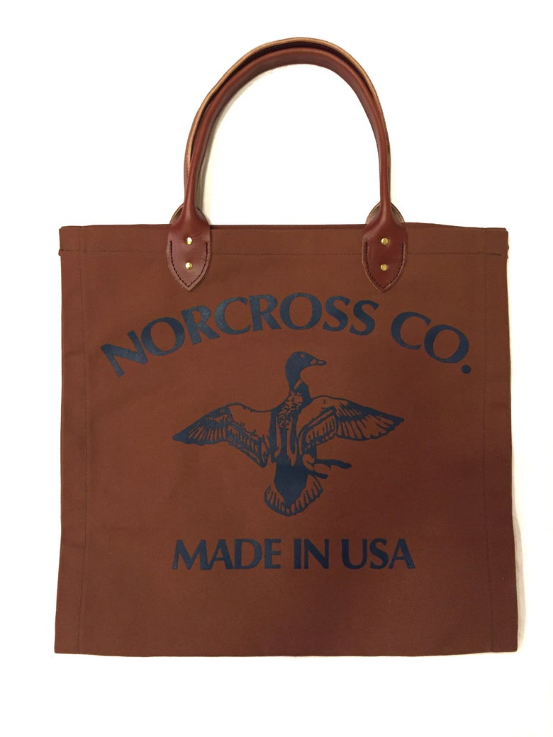 Image of Norcross Co. Canvas Log Carrier