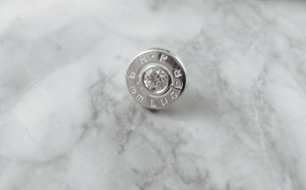 Image of 9mm Golden Saber Lapel Pin