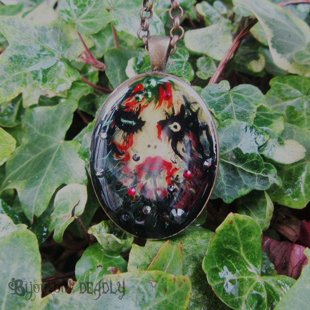 Image of Poison Ivy Bronze Oval Pendant
