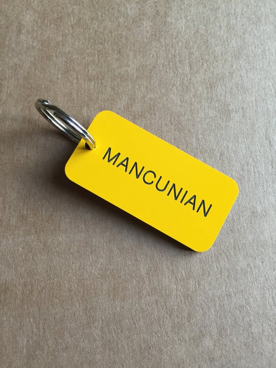 Image of Mancunian Keyring in Yellow + Black