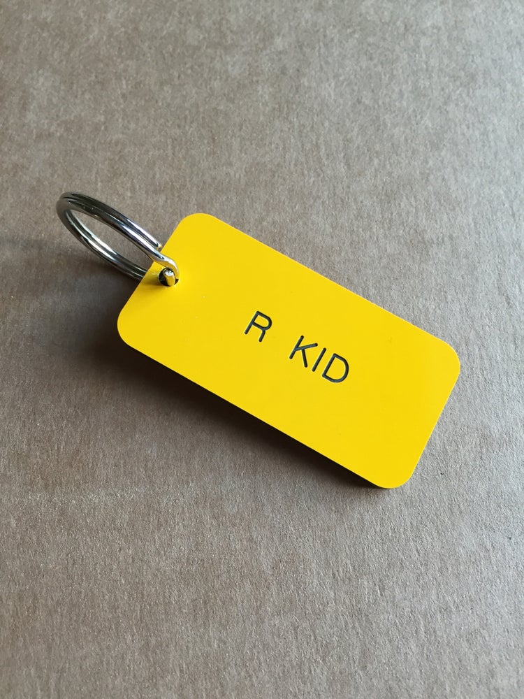 Image of R KID MANCHESTER LOCKER KEYRING IN YELLOW OR BLACK