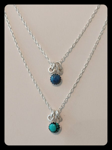 Image of gemstone necklace w/ rings