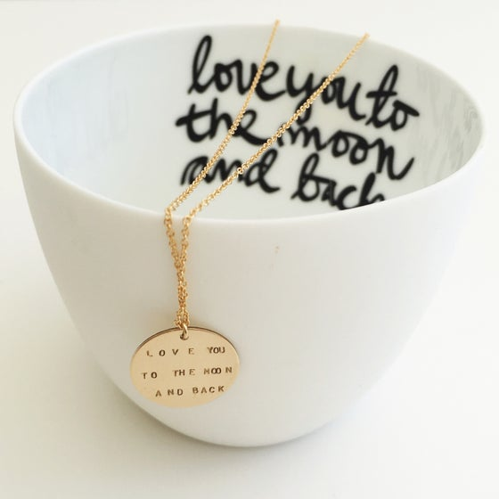 Image of Message on a necklace
