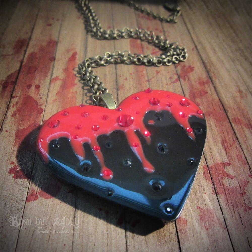 Bleeding Black Heart Resin Pendant