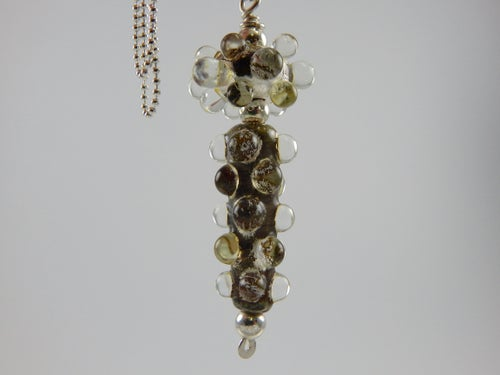 Image of Pendant with silver leaf and clear dots.