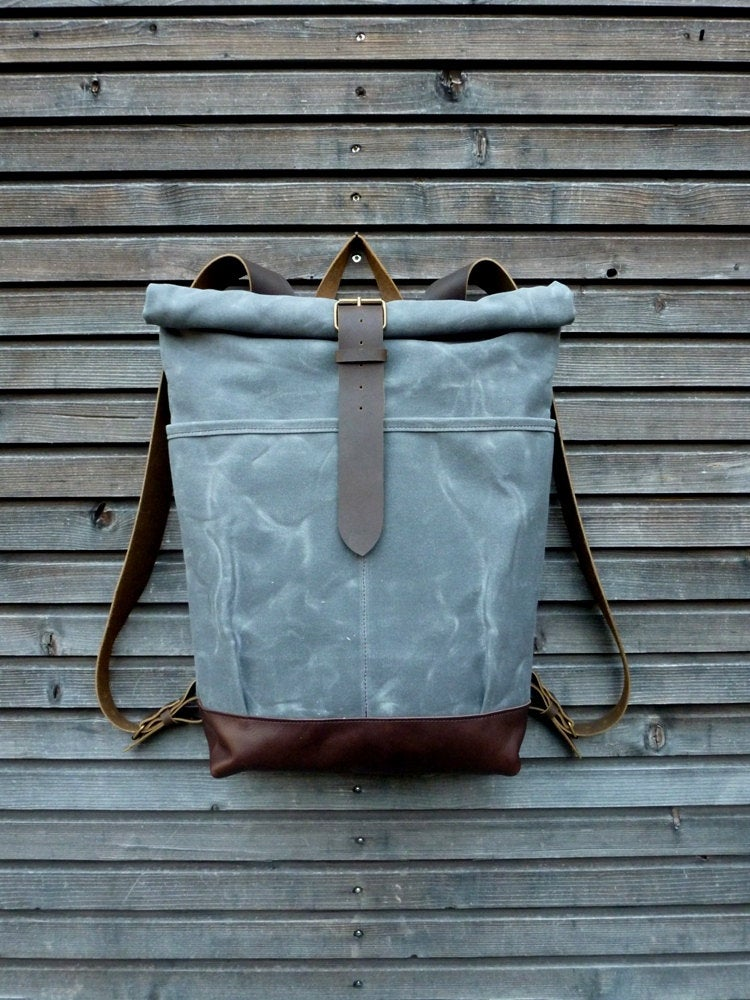 Image of waxed canvas backpack with roll to close top and leather bottom