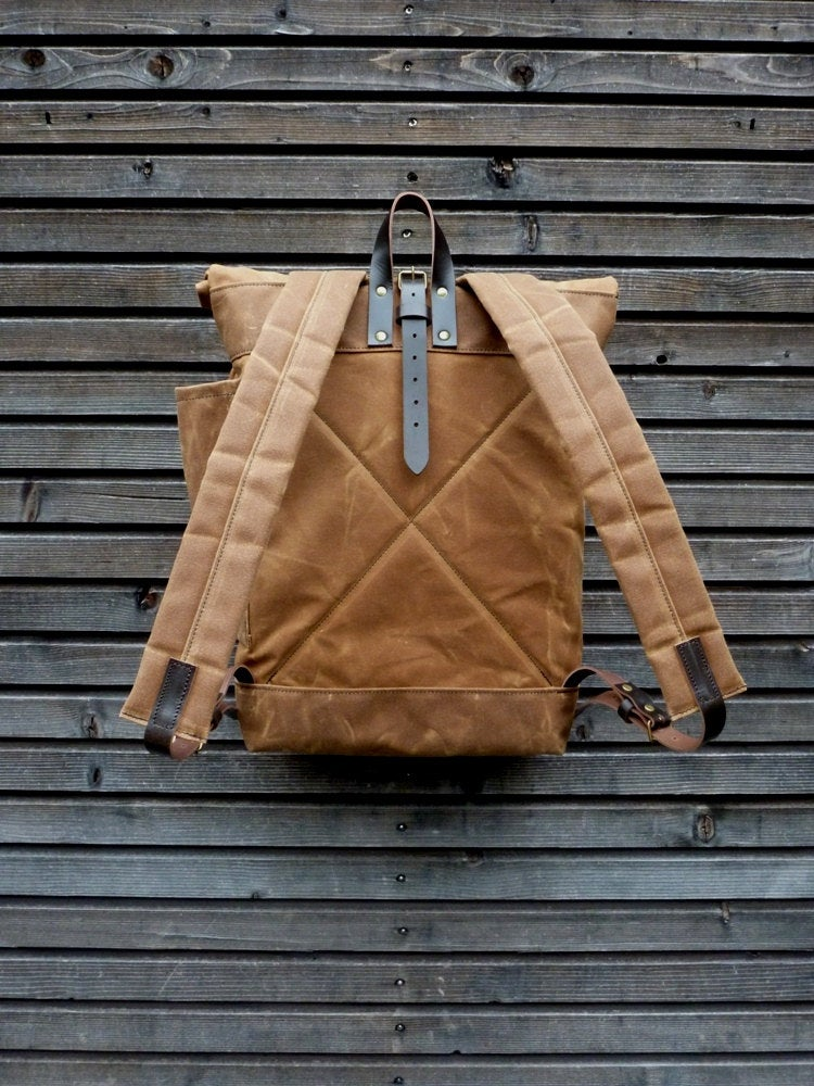 Image of Waxed canvas rucksack / waterproof backpack with roll up top and double waxed bottom