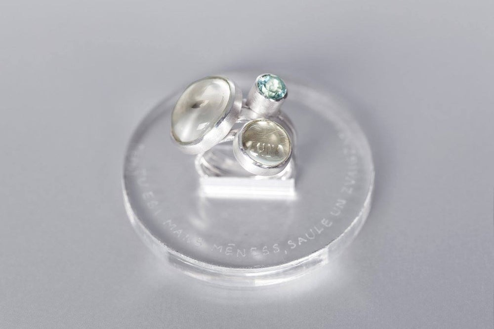 Image of silver rings with rock crystals and topaz TU ES MIHI LUNA ET SOL ET STELLAE