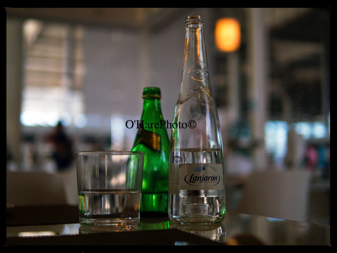 Image of BOTTLES & A GLASS