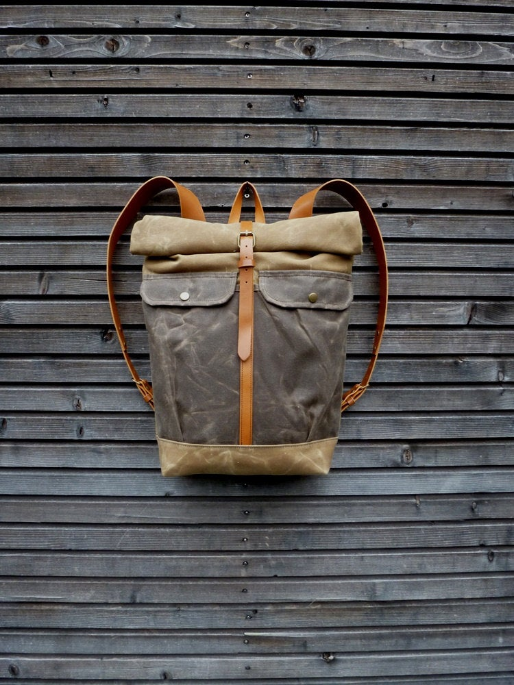 Image of Waxed canvas backpack with roll to close top and leather shoulderstrap and back reinforcement