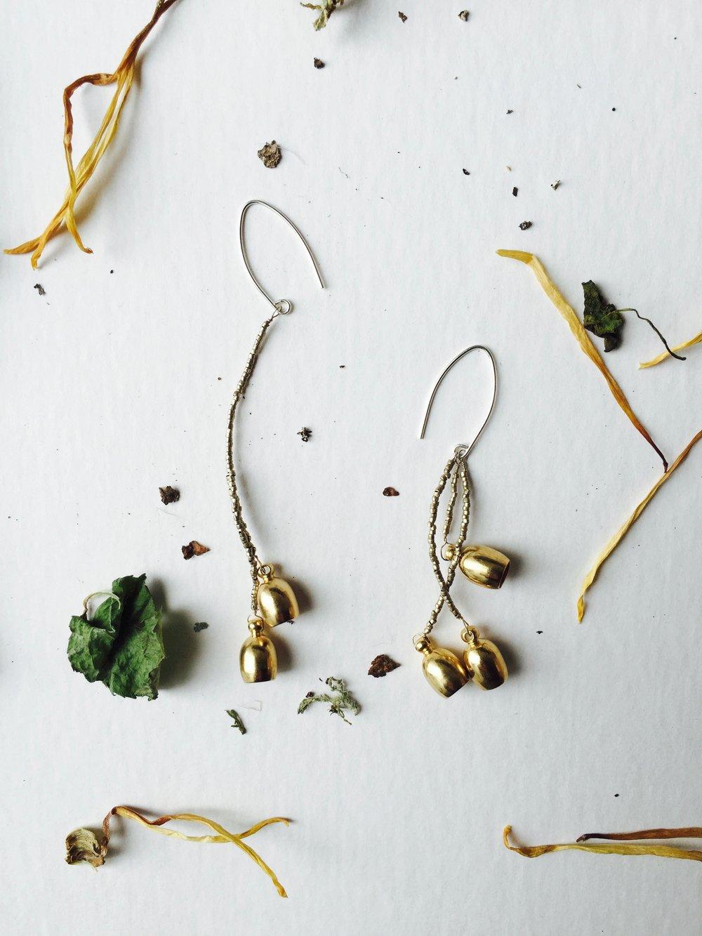 Image of Asymmetrical silver mixed brass Earrings