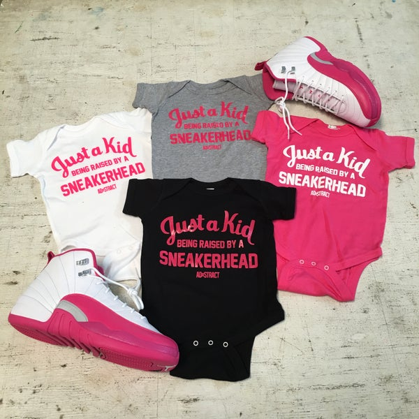 "Image of JUST A KID BEING RAISED BY A SNEAKERHEAD ""PINK/WHITE"" (INFANT)"