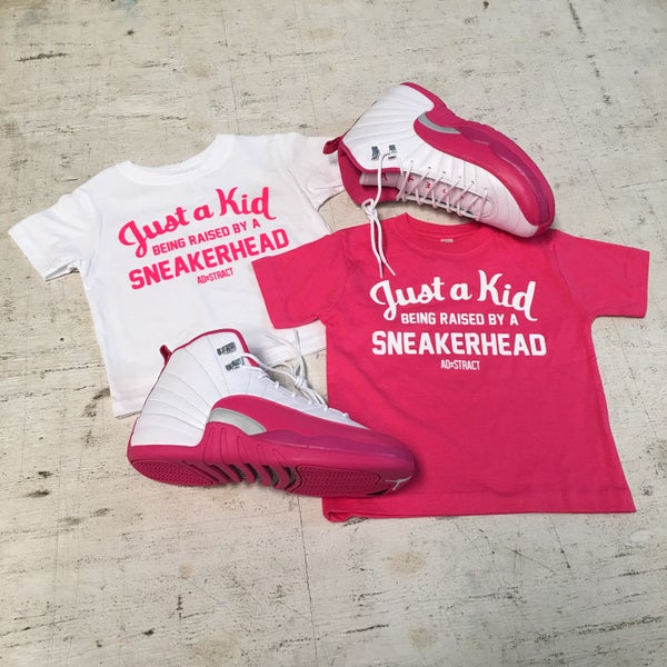 "Image of JUST A KID BEING RAISED BY A SNEAKERHEAD ""PINK/WHITE"" (INFANT/TODDLERS)"