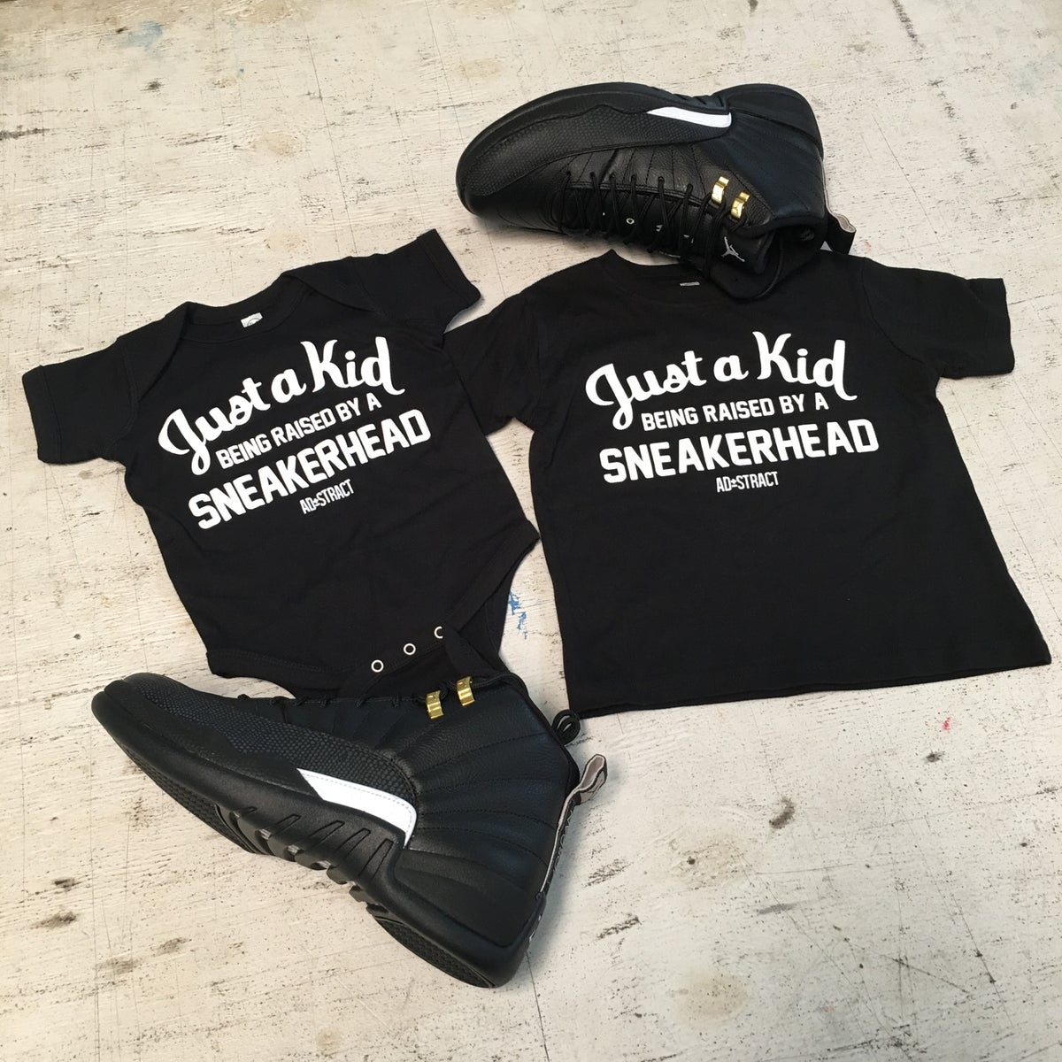 "Image of JUST A KID BEING RAISED BY A SNEAKERHEAD ""BLACK/MAROON"" (INFANT)"