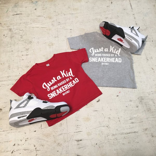 "Image of JUST A KID BEING RAISED BY A SNEAKERHEAD TSHIRT ""RED/HEATHER GREY"" (TODDLER)"