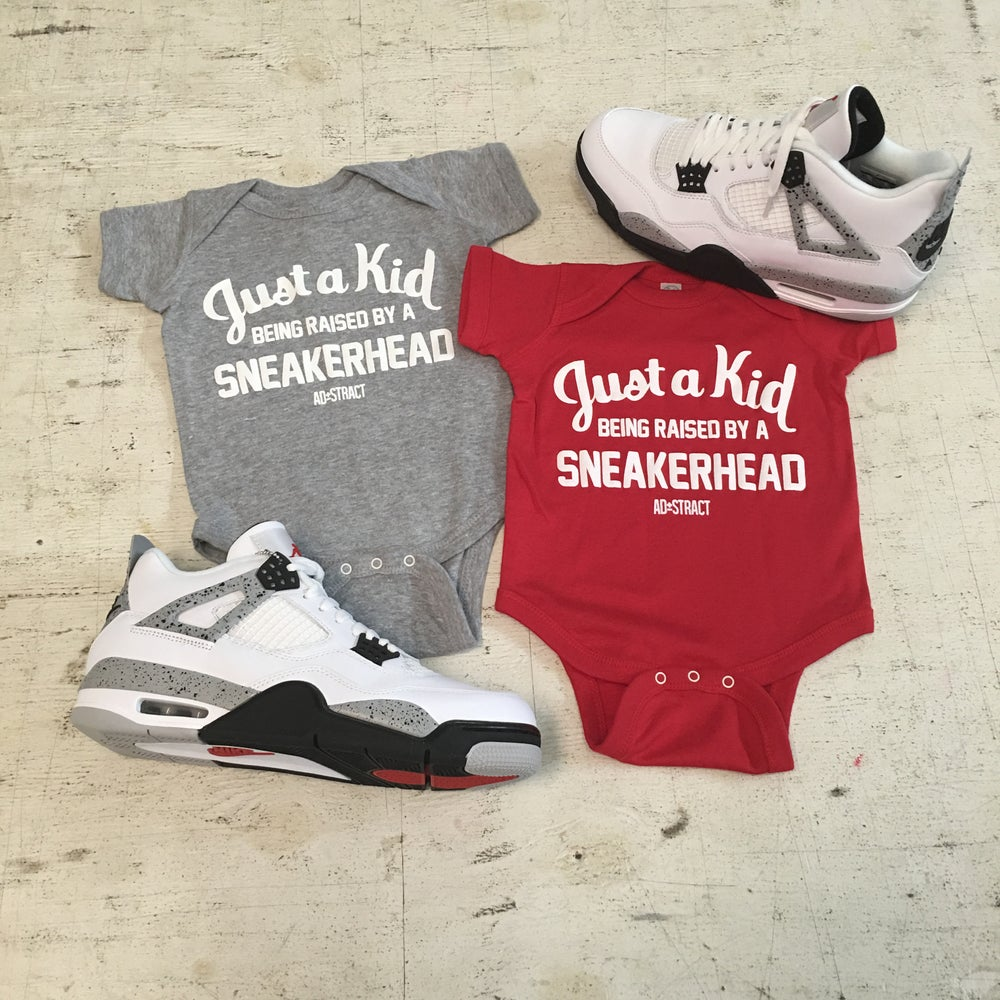 "JUST A KID BEING RAISED BY A SNEAKERHEAD ""RED/GREY W/WHITE PRINT"" (INFANT)"