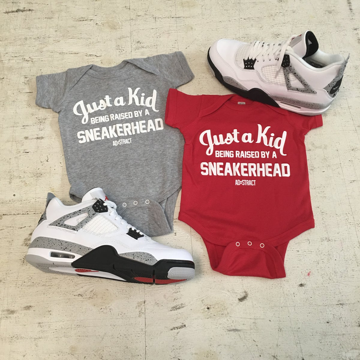 "Image of JUST A KID BEING RAISED BY A SNEAKERHEAD ""RED/GREY W/WHITE PRINT"" (INFANT)"