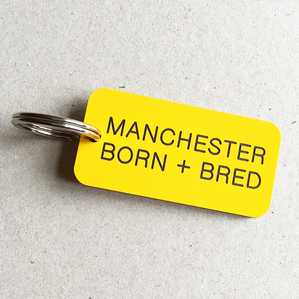 Image of Manchester Born + Bred Keyring in Yellow + Black