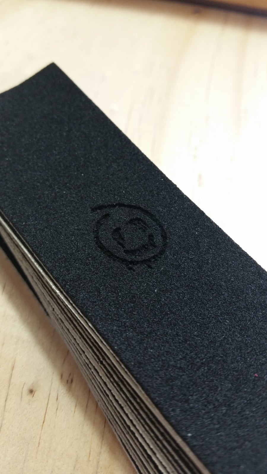 Image of Dislocation laser engraved griptape
